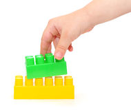 Color plastic blocks with hand Royalty Free Stock Photography