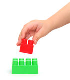 Color plastic blocks with hand Stock Photography