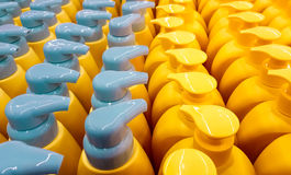 Color plastic bottles with lids in a row. Background Stock Image