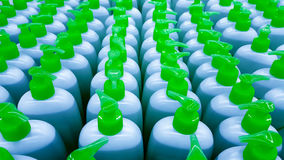 Color plastic bottles in a row. Background Stock Photography