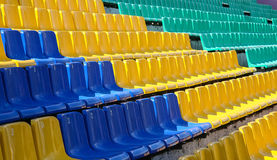 Color plastic chairs at stadium Stock Image