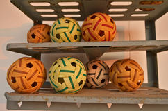 Color plastic takraw ball in the shelves Royalty Free Stock Image