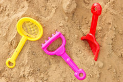 Color plastic toys on a sand. Set of color plastic toys on a sand Stock Image