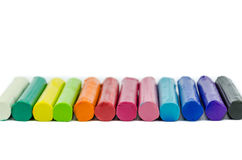Color plasticine on white background Stock Photos