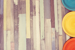 Color plates on a wooden table. Royalty Free Stock Photography