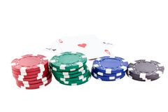 Color poker chip stacks and two ace cards Royalty Free Stock Images