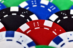 Color poker chips. Many color poker chips background, close up stock photo