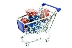 Color poker chips in shopping trolley Stock Photo