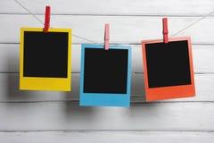 Color polaroid photos hanging Stock Photo