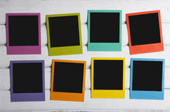 Color polaroids. Eight color polaroid frames on wooden background Royalty Free Stock Photography