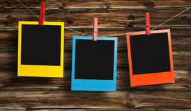 Color polaroids. Color polaroid frames in front of wooden background Royalty Free Stock Photo