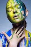 Color portrait of Girl in Paint royalty free stock photo