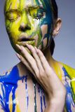 Color portrait of Girl in Paint. royalty free stock photo