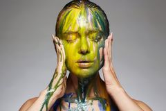 Color portrait of Girl in Paint Royalty Free Stock Images