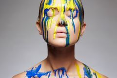 Color portrait of Girl in Paint over face and Body Stock Images