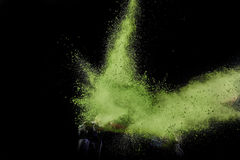 Color powder exploded, isolated on control environment. Stock Images