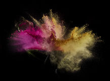 Color powder exploded, isolated on control environment. Can be use for abstract creative image editing Stock Image
