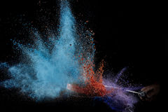 Color powder exploded, isolated on control environment. Stock Image