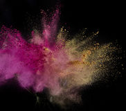 Color powder exploded, isolated on control environment. Stock Photo