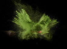 Color powder exploded, isolated on control environment. Stock Photos