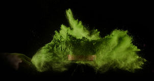 Color powder exploded, isolated on control environment. Stock Photography