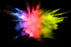 Color powder explosion. On black background stock image