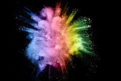 Color powder explosion. On black background royalty free stock photos