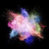Color powder explosion isolated on black Stock Photos