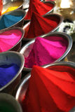 Color powder vertical. Color powders being sold in Indian market vertical. Focus on pink powder Royalty Free Stock Photos