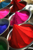 Color powder vertical. Color powders being sold in Indian market vertical Royalty Free Stock Images