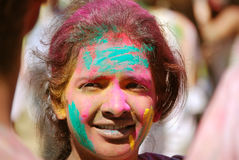 Color powder on a young lady Spring Festival Stock Photography