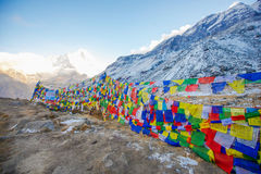 Color prayer flags on top of Annapurna base camp Stock Image