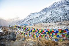 Color prayer flags on top of Annapurna base camp Stock Photo