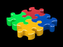 Color puzzle on black background Stock Photography
