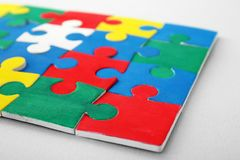 Color puzzle on background. Color puzzle on light background Stock Photos