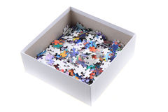 Color puzzle in the paper box. Isolated on the white background Stock Image