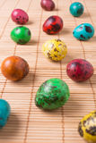Color quail eggs on the straw background Royalty Free Stock Image