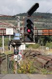 Color railway signal, signs, feather for junction. Railway color signal with three aspects, at present showing red, with other signs on the same post including a Stock Photos