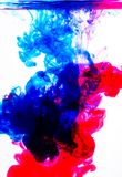 Blue and red acrylic colors in water on white. Color red blue acrylic background graphic macro stock illustration