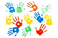 Multicolored painted hand prints on white. Color red colored paint painted multicolored print stock photography