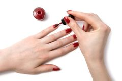 Color red nails. On white royalty free stock image