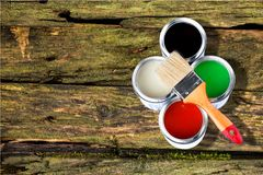 Multicolored Paint Cans on wooden background. Color red paint cans home improvement paint brush cans of paint stock photos