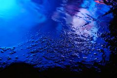 Color reflection in the asphalt after the rain in the evening Stock Image