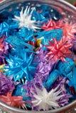 Color ribbon wraped coin Royalty Free Stock Photos