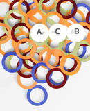 Color rings with shadows on gray abstract background Stock Photos