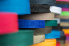 Color rolls with synthetic fabric straps. Rolls with color synthetic thread straps. Sewing production furniture Royalty Free Stock Images