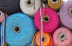 Color ropes. Various color ropes and yarns on coils Stock Images