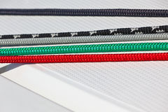 Color ropes on white boat deck background Stock Photo