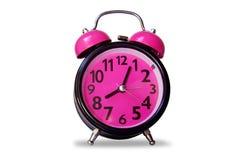 Color rosado negro del despertador - opóngase en blanco Imágenes de archivo libres de regalías