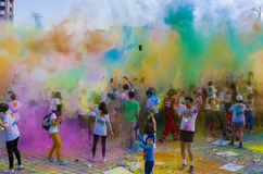 The Color Run Bucharest. Racers throw colored powder in the air at The Color Run event on April 25, 2015 in Bucharest, Romania. The Color Run is an event series royalty free stock photos